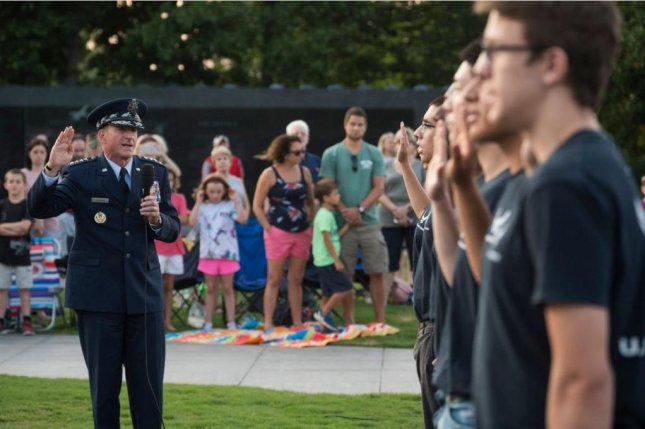 Air Force Chief of Staff Gen. David L. Goldfein administers the oath of enlistment to Air Force recruits at the Air Force Memorial in Arlington, Va., July 26, 2019. The Air Force and the U.S. Army each announced they had achieved their recruitment goals in Fiscal Year 2019. Photo by Adrian Cadiz/U.S. Air Force