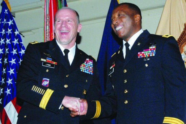 U.S. Transportation Command chief Gen. Stephen Lyons, L, seen here with Brig. Gen. Ronald Kirkland, R, told a Senate committee on Thursday that the U.S. sealift fleet is in need of recapitalization. File Photo courtesy of U.S.Army