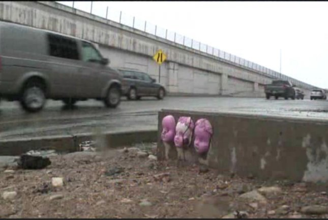 Mysterious baby faces resembling doll heads have been appearing around Denver for several months. Screenshot: KDVR-TV
