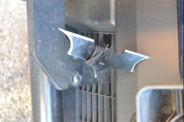 This batarang thrown by a fleeing suspect Monday lodged itself in the front of a police SUV. Photo courtesy of the Seattle Police Department