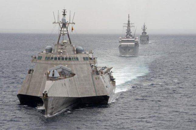 North Korea is condemning the United States after the USS Gabrielle Giffords (L), exercised with the Japan Maritime Self-Defense Force in June in the South China Sea. File Photo by Mass Communication Spc. 2 Brenton Poyser/U.S. Navy