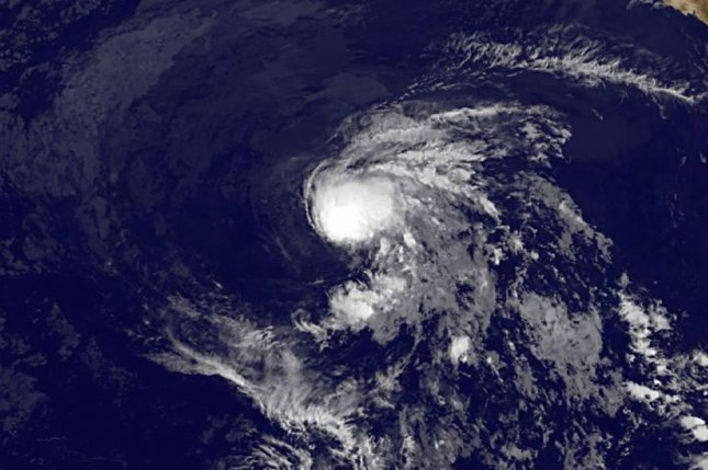 A satellite image shows Tropical Storm Enrique. Photo by NASA/NOAA GOES Project
