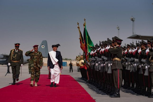 Afghan President Ashraf Ghani reviews his troops at a ceremony to officially accept Black Hawk helicopters from the United States. Photo by Staff Sgt. Alexander W. Riedel/U.S. Air Force