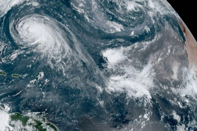 Tropical Storm Wilfred is is currently forecast to dissipate well to the east of the Lesser Antilles. Hurricane Teddy is to the west of Wilfred. Photo courtesy of NOAA