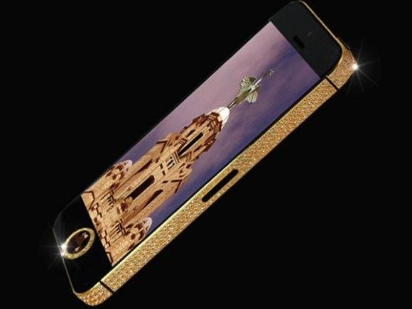 Craftsman Stuart Hughes says this gold and diamond iPhone 5 is the most expensive phone in the world at $15 million. (Stuart Hughes)