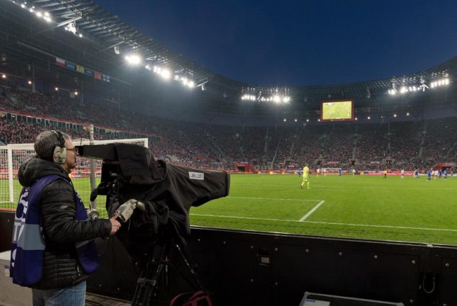 Automated sports cameras are watching human-controlled cameras to learn how to better follow the action. Automated sports cameras are less adept at filming soccer because player formations yield less information about where the ball is most likely to go next. Photo by Dziurek/Shutterstock