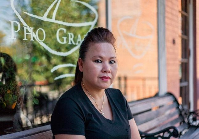 Hang Nguyen Trinh moved to the United States from embattled Saigon with her family when she was 11 years old. She manages the best-known Vietnamese restaurant in the St. Louis area. Photo by Nathan Parker/Refugees Deeply