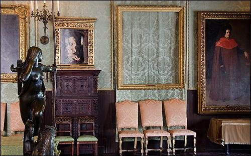 Empty frames in the Dutch Room of the Gardner Museum show where Rembrandt's The Storm on the Sea of Galilee and A Lady and Gentleman in Black once hung. (FBI)
