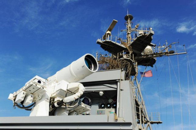 Afloat Forward Staging Base USS Ponce conducts an operational demonstration of the Office of Naval Research-sponsored Laser Weapon System. Photo courtesy of U.S. Navy.