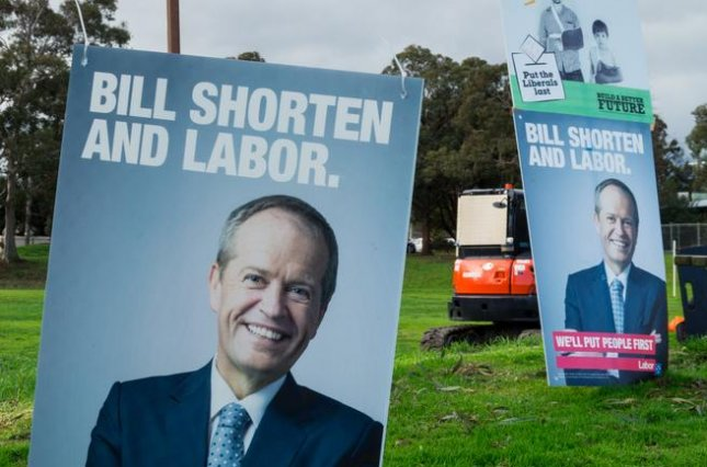 Posters backing Australian Labor Part leader Bill Shorten appear at the Mullauna College polling place on Saturday. Shorten says Australian Prime Minister Malcolm Turnbull should resign as the election remains deadlocked with voting to resume Tuesday. Photo by Nils Versemann/Shutterstock