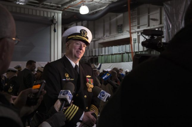 Capt. Todd A. Beltz, the USS Enterprise's final commanding officer, answers questions during a media availability following the Enterprise decommissioning ceremony in Newport News, Va., on Friday. Enterprise was decommissioned at Newport News Shipbuilding after 51 years patrolling the high seas. Photo by Navy Mass Communication Specialist 2nd Class Tyler Preston/UPI