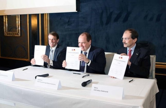 From left: Eirik Lie, president of Kongsberg Defence Systems, Dr. Peter Feldhaus, chief executive officer of Thyssenkrupp Marine Systems, and Dr. Rolf Wirtz, CEO of Atlas Elektronik, at a partnering agreement signing to form a joint venture company creating combat systems for Thyssenkrupp submarines.