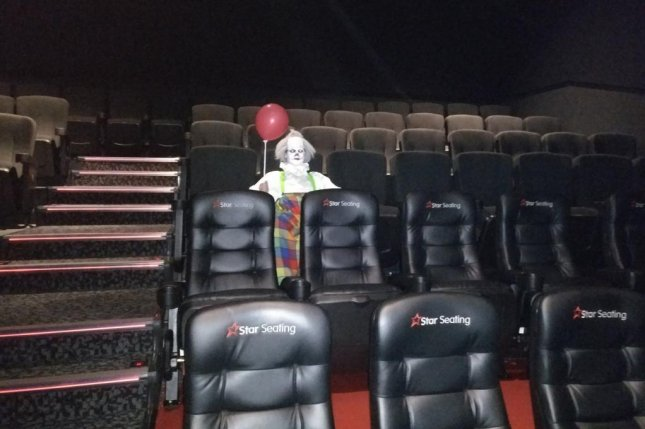 A man attending a screening of It at a movie theater in England received a scare when he walked into the near-empty theater and found a creepy clown holding a balloon. Photo by HG_Hohbes/Twitter