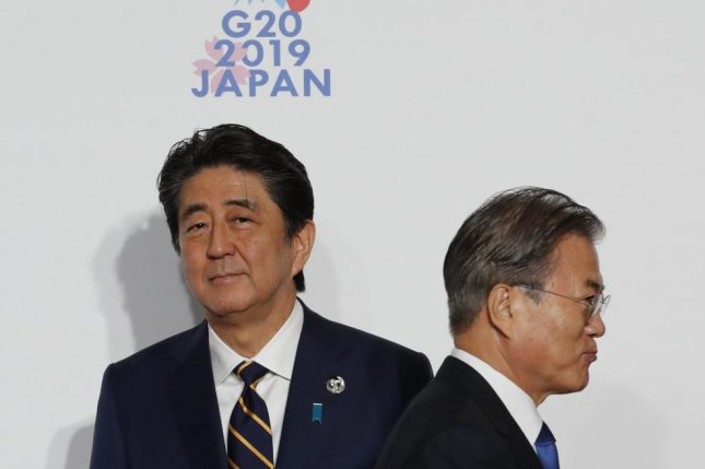 Japanese Prime Minister Shinzo Abe (L) may be irritated with South Korean President Moon Jae-in (R) for siding with victims of forced wartime labor. File Photo by Kim Kyung-hoon/EPA-EFE