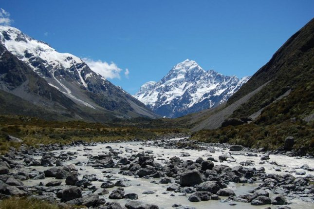 As alpine glaciers retreat, less meltwater flows into alpine watersheds similar to the river pictured trickling through the valley beneath Mount Cook, in New Zealand. Photo by Lee Brown