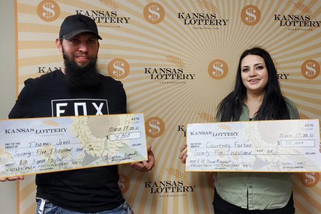Thomas Jones and Courtney Farber said taking an extra trip to the store to buy groceries for Jones' mother led them to a $75,000 lottery prize. Photo courtesy of the Kansas Lottery