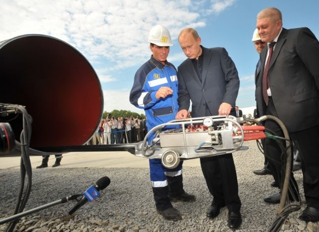 Russian Prime Minister Vladimir Putin takes part in the welding of the first joint of a gas transmission system for the Russian Far East. (Photo: Gazprom)