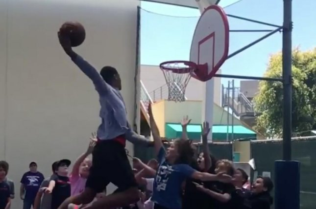 Shareef O'Neal dunks over son young fans Saturday. Photo courtesy of Shareef O'Neal/Instagram