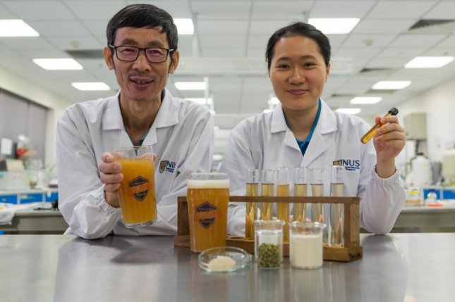 Associate Professor Liu Shao Quan and Chan Mei Zhi Alcine from the Food Science and Technology Program at the National University of Singapore created a novel probiotic beer that boosts immunity and improves gut health. Photo courtesy of the National University of Singapore