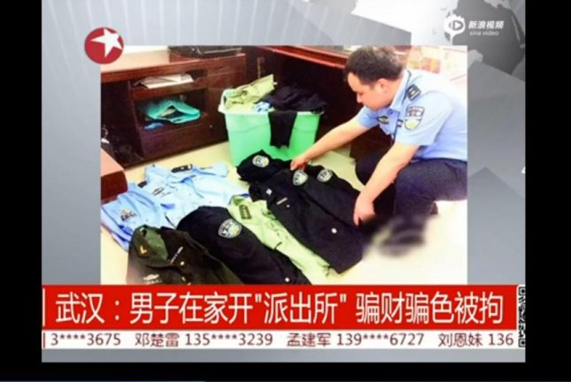 Police in Wuhan City found a man had converted his apartment into a fake police station. Forged documents, fake police uniforms and other pieces of equipment were seized from the home. Sina Video screenshot