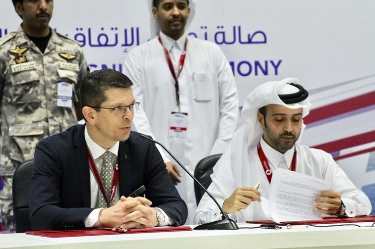 Kongsberg CEO Geir Håøy and Hamad Al Hajri, Program Director Barzan Holdings, signing the agreement in Doha, Qatar. Photo courtesy of Kongsberg