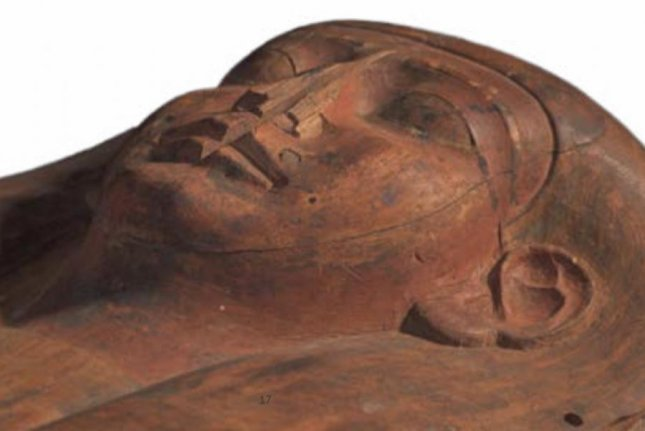 A closeup showcases the face carved into the coffin of the ancient Egyptian woman Mer-Neith-it-es. Photo by Muse/Nicholson Museum/University of Sydney