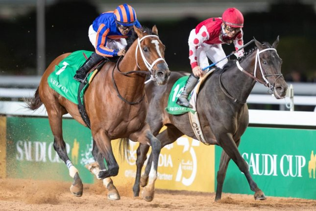 Maximum Security, shown winning the $20 million Saudi Cup (blue and orange silks) is the favorite for Saturday's Awesome Again Stakes at Santa Anita. Photo by Neville Hopwood, courtesy of the Jockey Club of Saudi Arabia