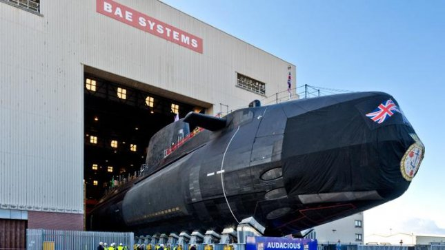 Britain's fourth Astute-class attack submarine, Audacious, pictured, was rolled out of a hangar Thursday, ahead of its lowering into the water Friday morning. The submarine will be commissioned Saturday before starting a year-long testing program to lead up to its sea trials in 2018. Photo courtesy BAE Systems