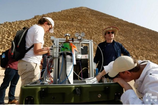 Researchers set up a muon detector outside the Great Pyramid of Giza. Photo by Scan Pyramids Mission/HIP Institute