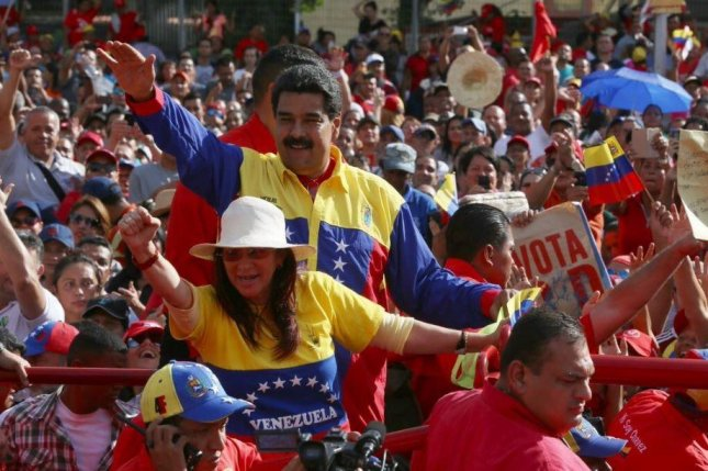 Venezuelan President Nicolas Maduro, seen here alongside his wife during a rally, has called on U.S. President Barack Obama to repeal an executive order he signed calling Venezuela's situation a threat to the United States. Maduro on Sunday said the decree is an atrocity that I hope Barack Obama corrects before he leaves office. Photo courtesy Prensa Presidencial