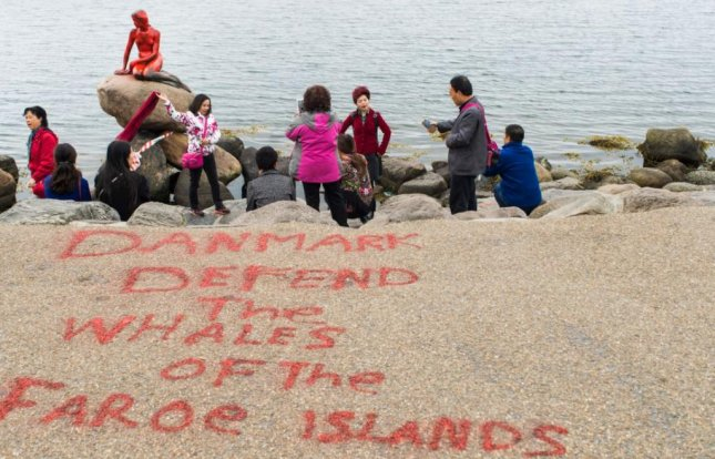 Copenhagen's iconic Little Mermaid sculpture, overlooking the water, was discovered doused in red paint Tuesday, with an anti-whaling slogan painted on a nearby walkway. Photo by Ida Marie Odgaard/EPA