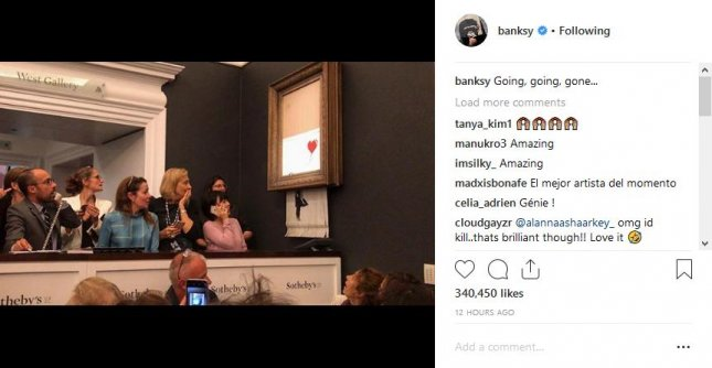 Banksy bragged about his stunt Friday at the London auction in a post on Instagram showing stunned onlookers, where he wrote, going, going, gone. Photo by Banksky/Instagram