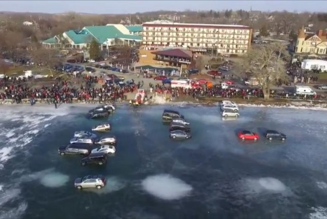 watch 15 cars fall through ice into lake geneva upi com