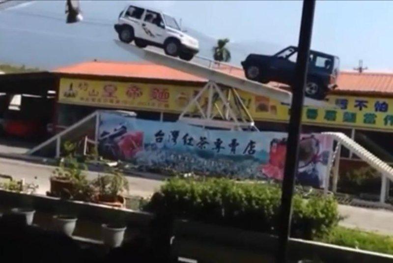 4x4s ride a giant see-saw in Taiwan. Newsflare video screenshot