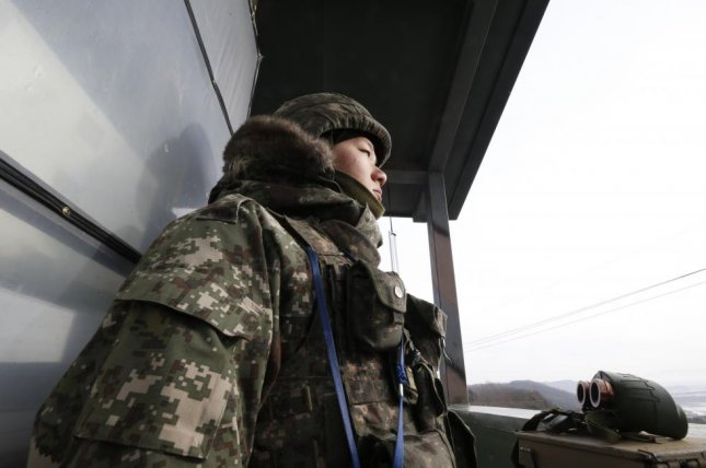 A South Korean soldier with the country's 25th infantry division stands guard at an outpost in Yeoncheon, South Korea. File Photo by Yonhap
