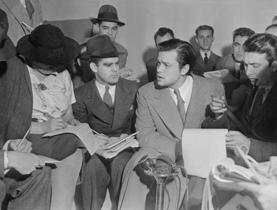 Author Orson Welles meets with reporters on October 31 1938 to explain the radio broadcast of The War of the Worlds was not expected to cause panic. Photo courtesy Wikipedia