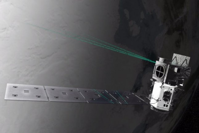 Every second, IceSat-2's laser pulses bounce 300 trillion photons of green light off Earth's surface. Photo by NASA