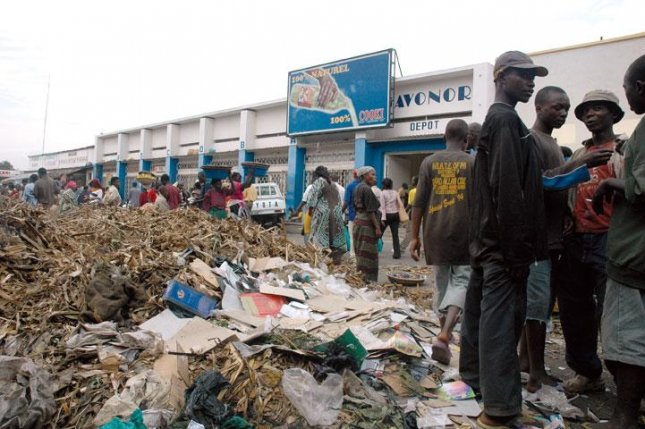 Burundians stand near a market in the capital, Bujumbura, in August 2006. On Nov. 7, 2015, gunmen stormed a bar in Bujumbura and killed at least nine people. The killings came on a government deadline for Burundians to turn in illegal weapons. Photo by Geordie Mott/ Wikimedia Commons