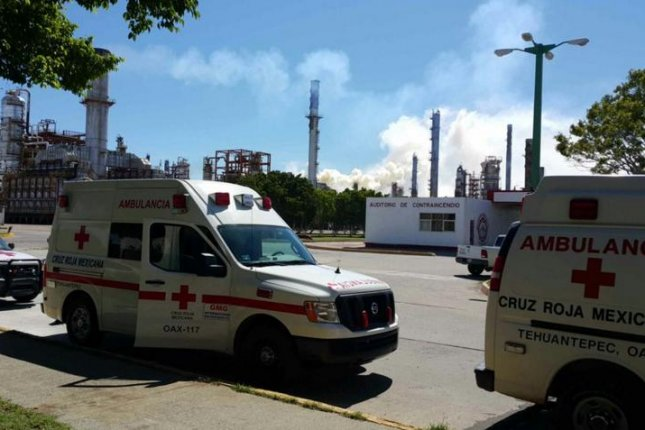 At least three people were seriously injured after an explosion at an oil refinery in Mexico on Tuesday, which led to the evacuation of about 2,000 workers. Several schools surrounding the refinery were evacuated. The Mexican Red Cross of the state of Oaxaca responded to the incident. Photo courtesy of Cruz Roja Mexicana - Estatal Oaxaca