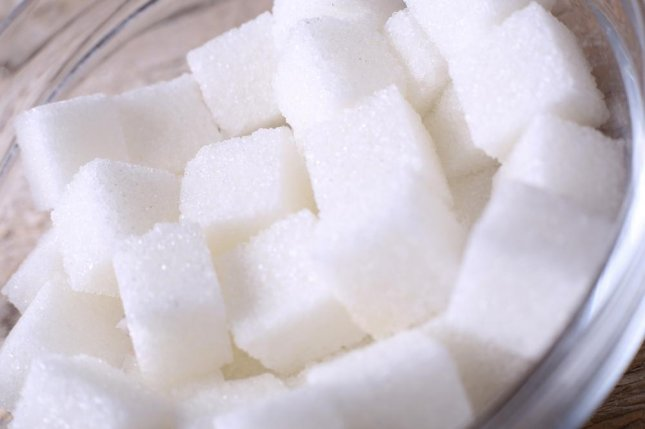Researchers say people can be addicted to sugar in ways similar to nicotine, finding that a drug designed to help people quit smoking may also help them stay away from the over-sweetened foods making them obese. Photo by flil/Shutterstock