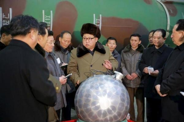 North Korean leader Kim Jong-un with scientists and reporters gathered around what is purported to be a miniaturized nuclear warhead in an undated photo released by North Korea's Korean Central News Agency on Wednesday. North Korea fired two short-range ballistic missiles on Thursday as already marred regional tensions continue to deteriorate. Photo courtesy of KCNA