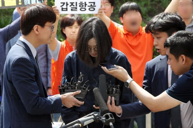 Cho Hyun-ah, daughter of Korean Air Chairman Cho Yang-ho, arrives at the main customs office in Incheon, South Korea, on June 4 to undergo questioning over alleged smuggling and tax evasion. File Photo by Yonhap/EPA-EFE