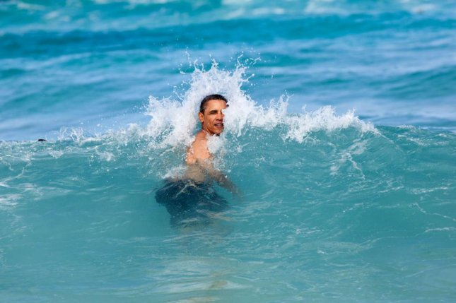 Jan. 1, 2012 A nice way to celebrate the New Year for the President was to jump in the ocean in his native state of Hawaii. He was on his annual Christmas vacation with family and friends, and went swimming at Pyramid Rock Beach in Kaneohe Bay. (Official White House Photo by Pete Souza)