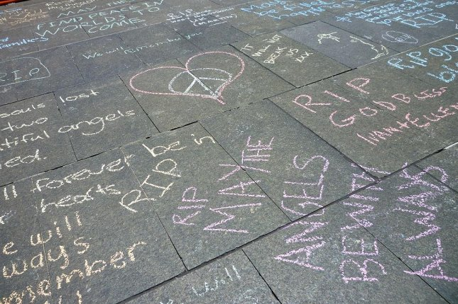 The Australian police raised the national terror threat level for police to high to correspond with the rest of the country. The increase is partially in response to the terrorist attack at a Sydney cafe on Dec. 15 that left three dead. Chalk messages have been left on the sidewalk outside the cafe. Photo by white ghost.ink/wikipedia/cc
