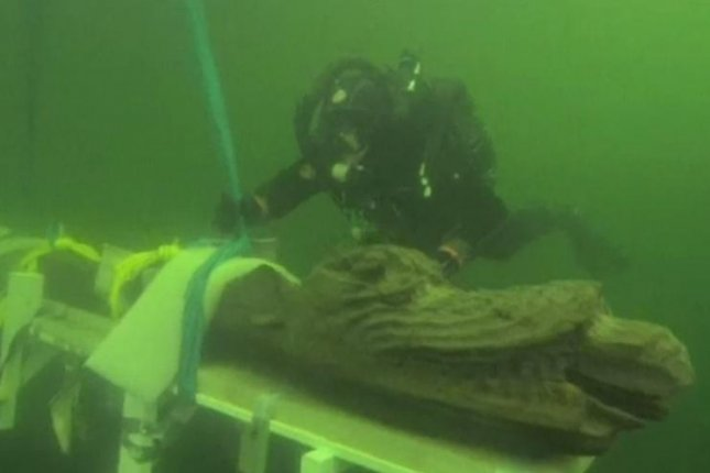 Archaeologists have raised a 500-yearold mythic figurehead from a sunken medieval warship off the coast of Sweden. Photo by Johan Ronnby/Sodertorn University