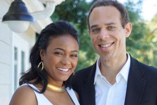 Tatyana Ali and her new husband, Vaughn Rasberry, an assistant professor at Stanford University. Photo by Tatyana Ali/Twitter.