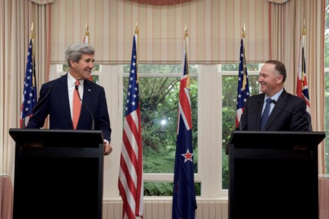Secretary of State John Kerry, standing at podiums with New Zealand Prime Minister John Key, said he plans to work until the last day of the Obama administration on Jan. 20 to keep the Paris climate agreement intact. . Photo from Secretary of State/Twitter
