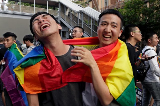 Supporters of same-sex marriage celebrate in Taipei, Taiwan, on Friday. Photo by Ritchie B. Tongo/EPA-EFE