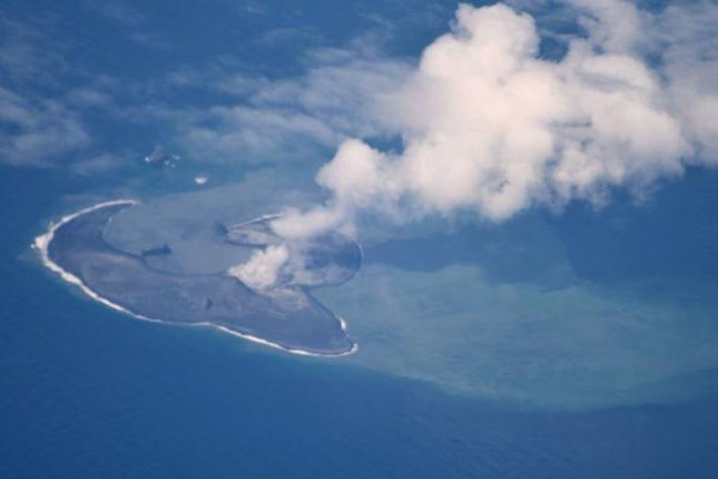 This photo of Bogoslof Island was taken on June 11 from an Alaska Airlines jet en route to Adak. The Bogoslof volcano erupted again Saturday. Photo courtesy of Cyrus Read/U.S. Geological Survey/Alaska Volcano Observatory