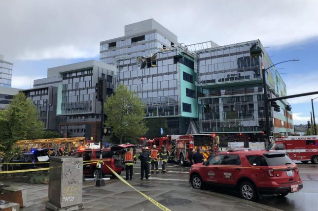 A construction crane crashed down on cars in downtown Seattle on Saturday, killing four people, including two workers, authorities said. Photo courtesy Seattle Fire Department/Twitter
